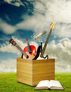 Music eduction concept, Music instrument and book with nice landscape backgro - stock photo