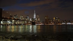 Panoramic Night Time Lapse of Brooklyn Bridge and Manhattan Skyline in NYC - stock footage
