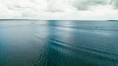 Aerial view of a fast fishing boat speeding in clean blue water Stock Footage
