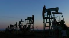 Many working oil pumps silhouette in dusk, 4k Stock Footage