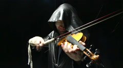 Blind man playing on a fiddle Stock Footage