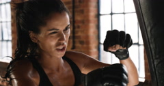 Kickboxing woman training punching bag in fitness studio Stock Footage