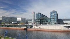 Berlin Hauptbahnhof as seen from the opposite bank of the river Spree - stock footage