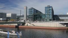 Boat on the River Spree passes Berlin Hauptbahnhof - stock footage