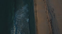 Aerial shot of waves on beach Stock Footage