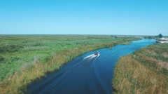 Aerial shot of airboat on swamp Stock Footage