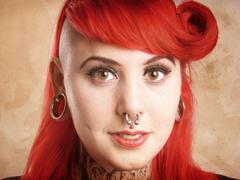 Girl with piercings and tattoos Stock Photos