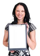 Smiling young business woman showing blank signboard over white - stock photo