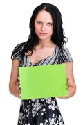 Smiling young business woman showing blank signboard over white Stock Photos