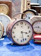 Old clocks at flea market Stock Photos