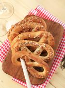Soft pretzels topped with caraway seeds and salt Stock Photos