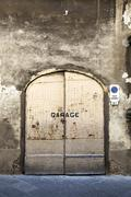 Rusty garage door - stock photo