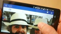 4K Smartphone Facebook Feed Browsing Stock Footage