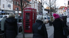 Red phone boxes on high street, Marlow, England Stock Footage