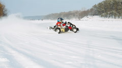 Kart racing on the frozen lake Stock Footage