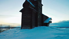 Old Wooden Church in a Snowy Winter Sunset Stock Footage
