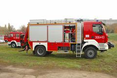 POZNAN, POLAND - OCTOBER 25: Fire brigade trucks during exercises on Warta ri - stock photo