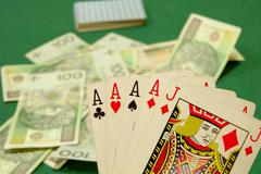 Poker cards four and jack and cash on poker table. Currency polish zloty. - stock photo