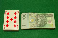 Poker cards and cash on poker table. Currency polish zloty. - stock photo