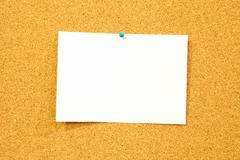 Cork board background - add text on white sheet of paper - stock photo