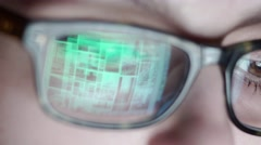 Closeup shot of boy in glasses surfing internet at night - stock footage