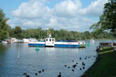 CAPUTH, GERMANY - SEPTEMBER 21: Car and passenger ferry in Caputh city in Ger - stock photo