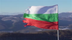 Bulgarian flag is shaken in slow motion on top of a mountain Stock Footage