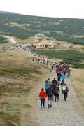 KARPACZ, POLAND - AUGUST 15: Unidentified people in crowd on trail in Karkono Stock Photos