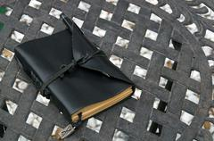 Stock Photo of leather covered artist notebook