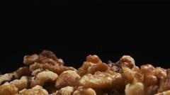 4K Walnuts Closeup Black Background Stock Footage