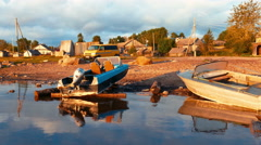 Landscape view of Sunrise on Lake with vessel boat in Village Stock Footage