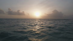 Aerial shot of sunset and ocean horizon Stock Footage