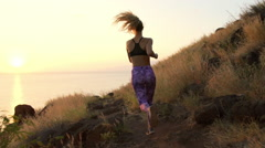 Young Athletic Woman Running on Mountain Trail. POV Follow Cam. Sunset Workou Stock Footage