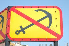 Yellow No Anchor sign - stock photo