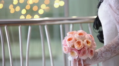The bride is holding a bouquet of peonies - stock footage