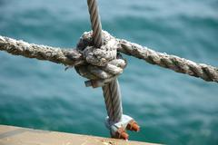 Clove hitch and shroud connection on old sailing vessel close up Stock Photos