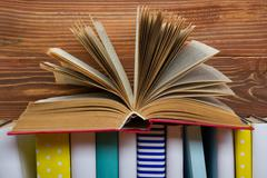 Open book, hardback books on wooden table. Back to school. Copy space - stock photo