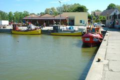 Rowy, Poland - May 25, 2014: Small fishing vessels in harbour in Rowy, Poland - stock photo