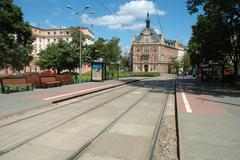 Stock Photo of Poznan, Poland - July 13, 2014: Tram stops and unidentified people walking on