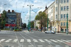 Poznan, Poland - July 13, 2014: Unidentified people and traffic on junction o - stock photo