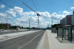 Poznan, Poland - July 13, 2014: Empty tram stop, track and crane in Poznan, P - stock photo