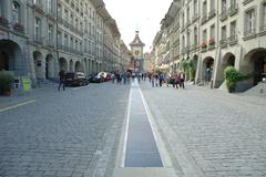 Bern, Switzerland - August 15, 2014: Unidentified people on cobbled street in Stock Photos
