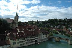 Bern, Switzerland - August 15, 2014: Bridge (Untertorbrucke), buildings and t Stock Photos