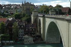 Bern, Switzerland - August 15, 2014: Bridge (Nydeggbrucke), buildings and tre Stock Photos