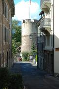 Stock Photo of La Tour-de-Peliz, Switzerland - August 16, 2014: Street and castle tower in L