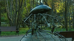 A monument in the form caught in the nets of cod in autumn park. Stock Footage