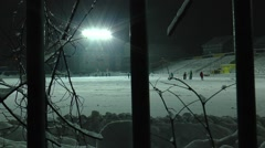 Snow-covered stadium and training of young hockey players. Stock Footage