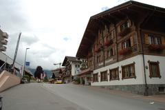 Grindelwald, Switzerland - August 19, 2014: Buildings, bus and unidentified p - stock photo