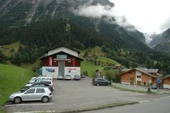 Grindelwald, Switzerland - August 19, 2014: Cars on parking at Pfinstegg cabl - stock photo