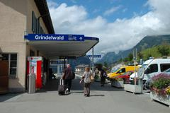 Grindelwald, Switzerland - August 19, 2014: Unidentified people walking at ra - stock photo